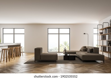 Interior of modern living room with white walls, concrete floor, white sofas and kitchen to the left. 3d rendering