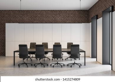 Interior of modern meeting room with white and brick walls, concrete floor and black table with chairs. Concept of discussion. 3d rendering