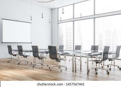 Interior of modern office meeting room with white walls, wooden floor and glass conference table with black chairs and mock up projection screen. 3d rendering
