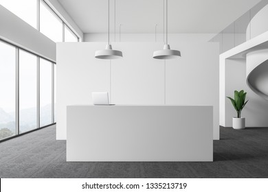 Interior of modern office waiting room with white walls, carpeted floor, panoramic windows and minimalistic reception desk with laptop on it. 3d rendering