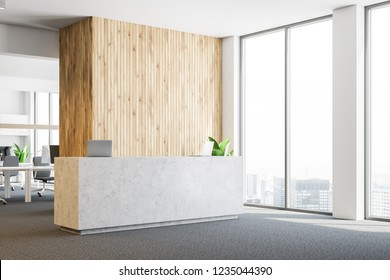 Interior of modern office with white and wooden walls, carpet on the floor, panoramic windows, stone reception desk with two laptops and open space area in the background. 3d rendering