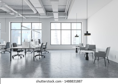 Interior of modern open space office in industrial style with white walls, concrete floor, long computer tables with chairs and lounge area with armchairs and coffee tables. 3d rendering