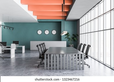 Interior of open space office with green and white walls, concrete floor, rows of white computer tables, gray reception desk and conference table with black chairs. 3d rendering