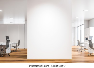 Interior of open space office of modern company with rows of computer desks and blank mock up wall in the center. 3d rendering