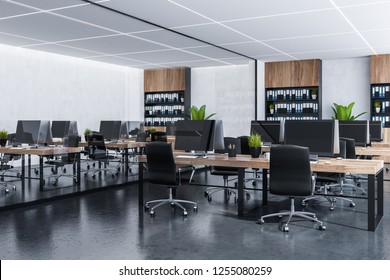 Interior of open space office with white walls, gray floor, rows of wooden computer tables with black chairs and wooden bookcases with folders. 3d rendering