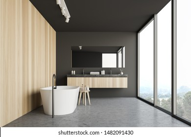 Interior of panoramic bathroom with gray and wooden walls, concrete floor, comfortable bathtub, double sink and window with magnificent scenery. 3d rendering
