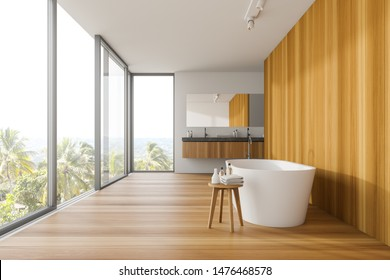 Interior of panoramic bathroom with white and wooden walls, comfortable bathtub, double sink and window with magnificent scenery. 3d rendering