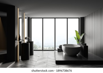 Interior of a panoramic bathroom with wooden and gray walls, wooden bathtub and two round sinks. Window with a blurry tropical view. 3d rendering