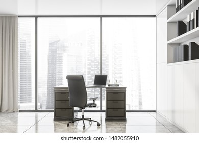 Interior of panoramic CEO office with cityscape, tiled floor, luxury gray table with laptop and black chair and white bookcase with folders. 3d rendering