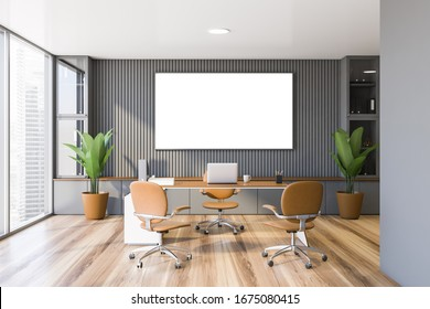 Interior of panoramic CEO office with gray walls, wooden floor, comfortable computer table with leather chairs for visitors. Horizontal mock up poster frame. 3d rendering