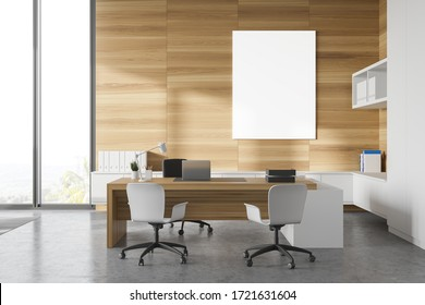 Interior of panoramic CEO office with white and wooden walls, wooden computer desk with chairs for visitors, vertical mock up poster and window with blurry tropical view. 3d rendering