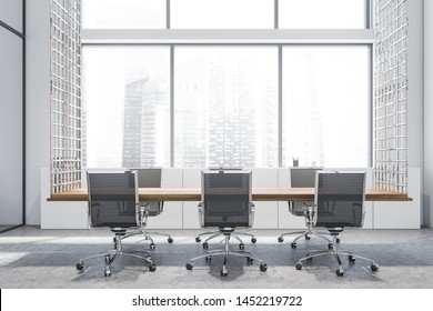 Interior of panoramic meeting room with white walls, large window, concrete floor and long wooden table with black armchairs. 3d rendering