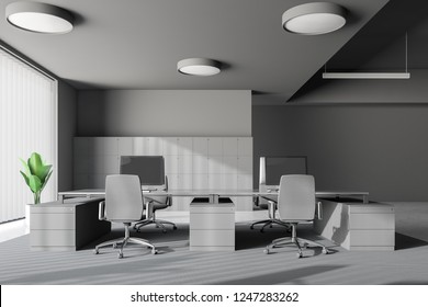 Interior of panoramic office with gray walls, concrete floor and big gray computer tables with chairs. Lockers near the wall. 3d rendering