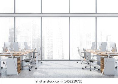 Interior of panoramic open space office with magnificent cityscape, concrete floor and wooden computer desks. 3d rendering
