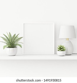 Interior poster mockup with square white frame standing on the table with plants in pots and lamp on empty wall background. 3D rendering, illustration.