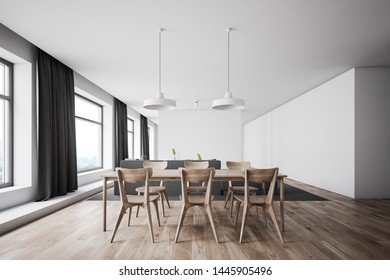 Interior of spacious dining room with white walls, wooden floor, large windows with curtains, wooden table with chairs and comfortable sofa. 3d rendering