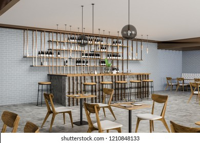 Interior of stylish bar and restaurant with gray brick walls, concrete floor, wooden table and stools. Bottles on shelves. Small tables with chairs. 3d rendering