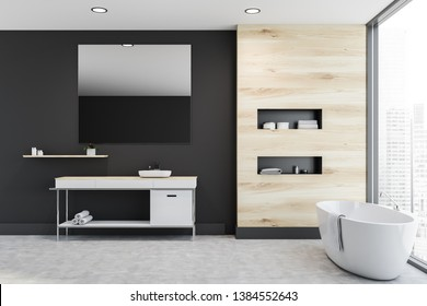 Interior of stylish bathroom with black and wooden walls, concrete floor, sink standing on white counter with large mirror above it and white bathtub. Shelves in the wall. 3d rendering