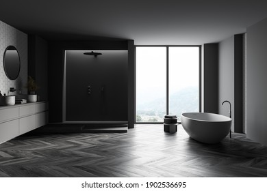 Interior of stylish bathroom with dark grey walls, concrete floor, round tub, shower stall and double sink with round mirrors. Blurry mountain view. 3d rendering