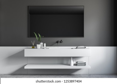 Interior of stylish bathroom with gray and white walls, concrete floor and long white sink with horizontal mirror hanging above it. 3d rendering