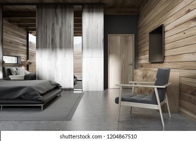 Interior of stylish bedroom with wooden walls, concrete floor, gray master bed and tv set on the wall. 3d rendering