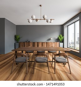 Interior of stylish dining room with gray walls, wooden floor, large windows, long wooden table with gray chairs and dark wooden cabinet. 3d rendering