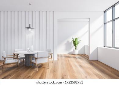 El interior es elegante, con paredes blancas, suelo de madera, una cómoda mesa redonda con sillones blancos y una maceta de fondo. Ventana con paisaje urbano borroso. Representación 3d