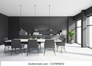 Interior of stylish kitchen with dark grey walls, tiled floor, long white wooden dining table with gray armchairs and bookcase. 3d rendering