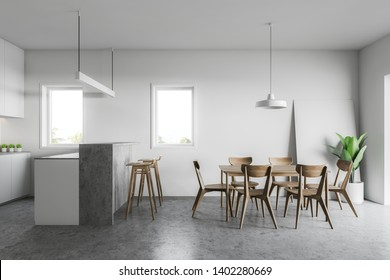 Interior of stylish kitchen with white walls, concrete floor, white countertops and gray bar with stools and wooden dining table with chairs. 3d rendering