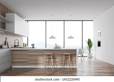 Interior of stylish kitchen with white walls, wooden floor, panoramic window, white countertops, wooden bar with stools and two built in ovens. 3d rendering