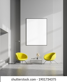 Interior of stylish minimalistic living room with grey walls, concrete floor, two bright yellow armchairs, coffee table and vertical mock up poster. 3d rendering