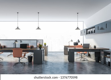 Interior of stylish open space office with white walls, panoramic windows with city view, long and small computer tables and long gray shelves with folders above them. 3d rendering