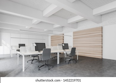 Interior of stylish open space office with white, brick and wooden walls, concrete floor, rows of white computer tables and file cabinets. 3d rendering