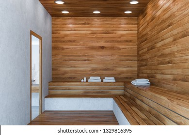 Interior of stylish sauna with wooden and concrete walls, wooden floor and benches with stacks of towels on them. 3d rendering