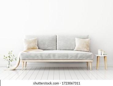 Interior wall mockup with gray velvet sofa, beige pillows and plaid, branch in vase and coffee table in living room with empty white wall background. 3D rendering, illustration.