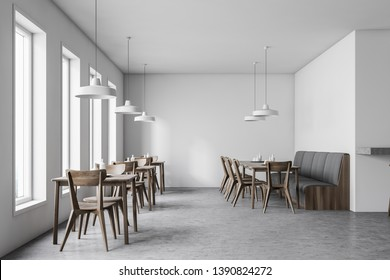 Interior of white cafe with concrete floor, dark wooden tables with chairs and gray sofa and industrial style lamps. 3d rendering