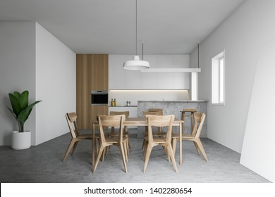 Interior of white and wooden kitchen with white countertops, gray bar, wooden dining table with chairs and cabinet with built in oven. 3d rendering