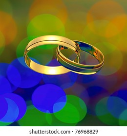 Interlocked golden rings on the blurry background
