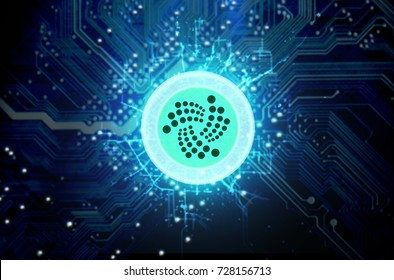 A iota cryptocurrency hologram coin form hovvering over a computer circuit board