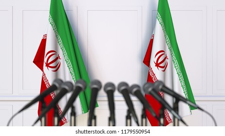 Iranian official press conference. Flags of Iran and microphones. Conceptual 3D rendering