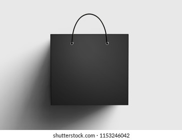 Isolated black paper bag mockup template lay down on the floor in 3d render, top view