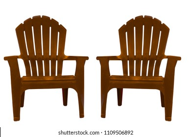 Isolated closeup of two brown Adirondack chairs turned very slightly inward toward each other and facing viewer. Original background removed. Chairs set against a solid white background.