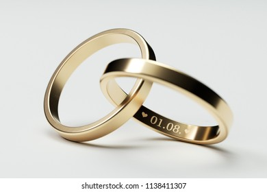 Isolated golden wedding rings with date 3D Illustration