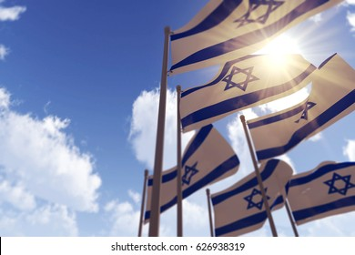 Israel flags waving in the wind against a blue sky. 3D Rendering