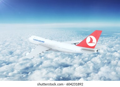 ISTANBUL , TURKEY - CIRCA 2017: Aerial view of Turkish Airlines Boeing 747 Commercial Passenger Aircraft Flying High Up in the Sky Above the Clouds. 3D Illustration.