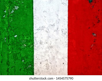 Italian national flag painting on a peeled  weathered wall. Grunge background.