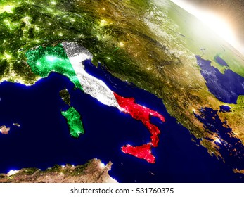 Italy with embedded flag on planet surface during sunrise. 3D illustration with highly detailed realistic planet surface and visible city lights. Elements of this image furnished by NASA.