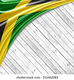 Jamaica flag  of silk with copyspace for your text or images and wood background