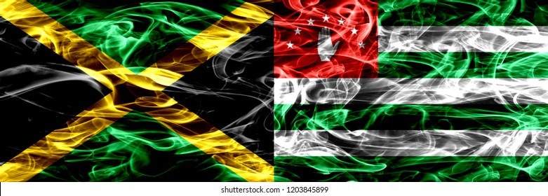 Jamaica vs Abkhazia, Abkhazian smoke flags placed side by side. Thick colored silky smoke flags of Jamaican and Abkhazia, Abkhazian