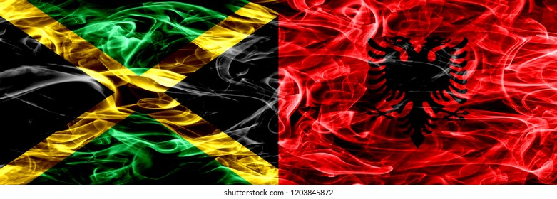 Jamaica vs Albania, Albanian smoke flags placed side by side. Thick colored silky smoke flags of Jamaican and Albania, Albanian